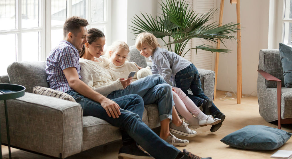 happy-family-with-children-using-smart-devic-in-living-room