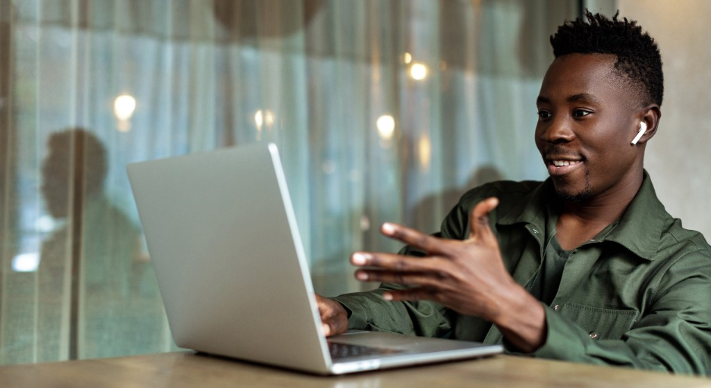 Man using laptop for video conference